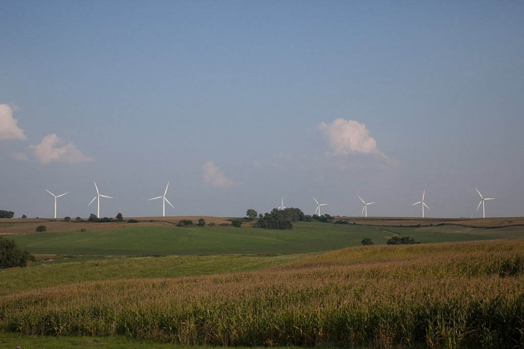 Windmills turn over farmers corn and soy fields