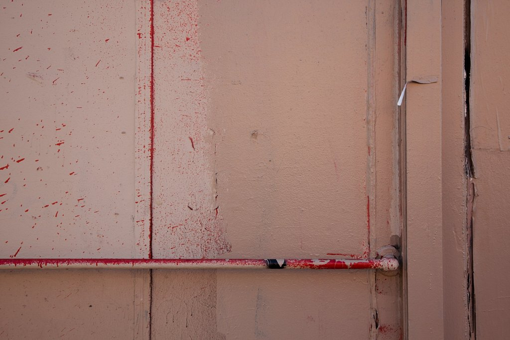 Wall detail with red spatters and various skin tones