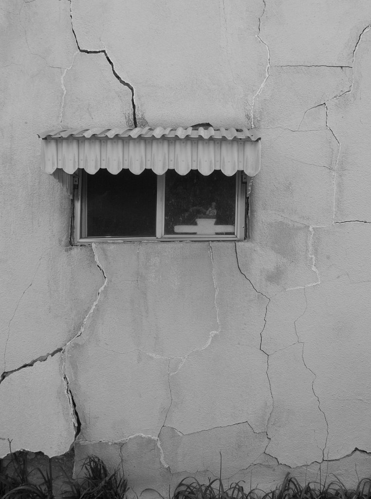 Window and cracked stucco in Nicodemus Kansas