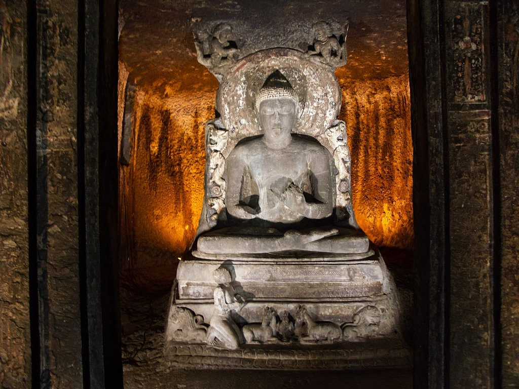 Sitting Buddha carved from stone at Ajanta Caves