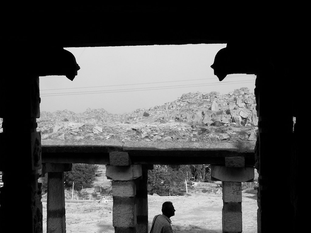 Man framed by old temple in Hampi