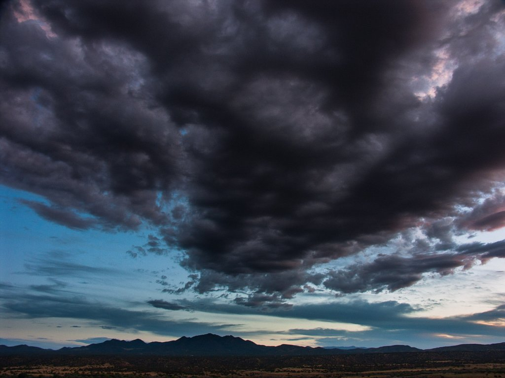 Dark clouds over the Ortiz mountains near Cerillos New Mexico