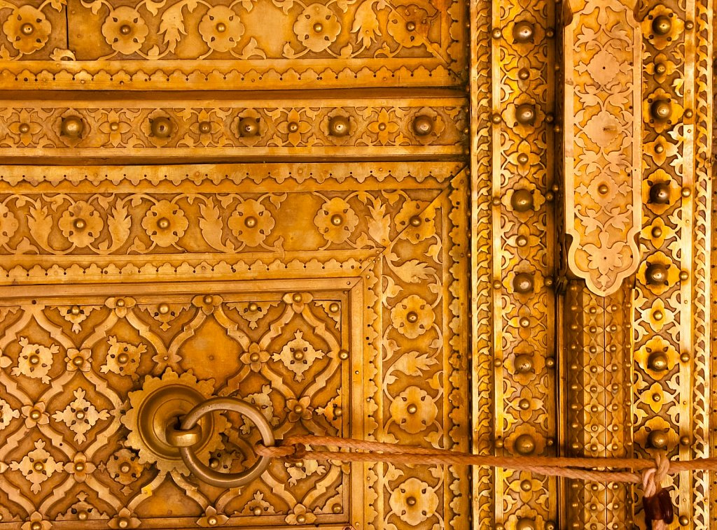 Detail of fine metalworking on a brass door in India