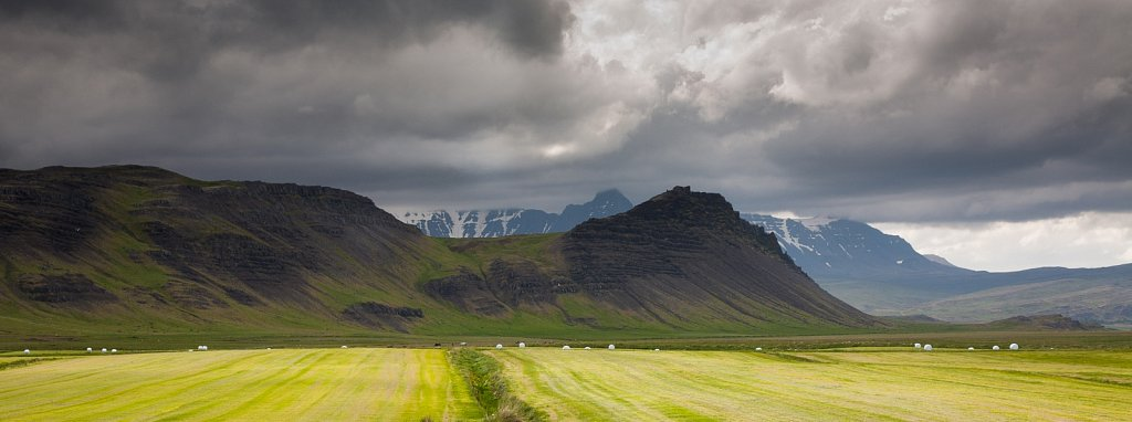 Hayed fields and mountains in Iceland
