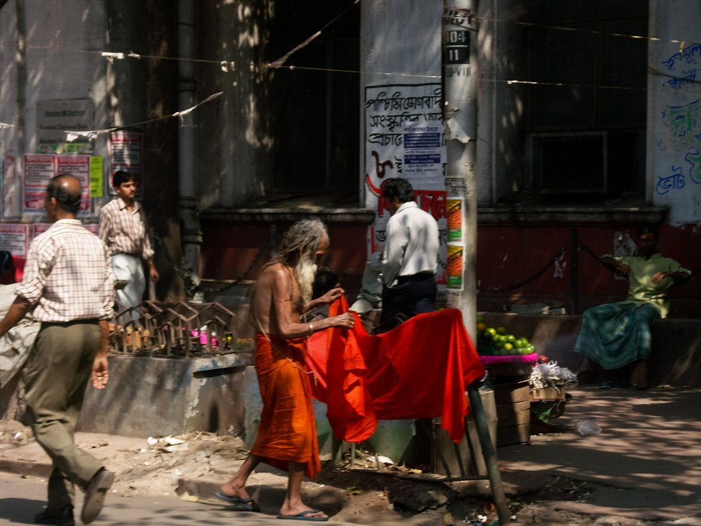 Sadhu adjusts his cloth on the streets on Kolkata
