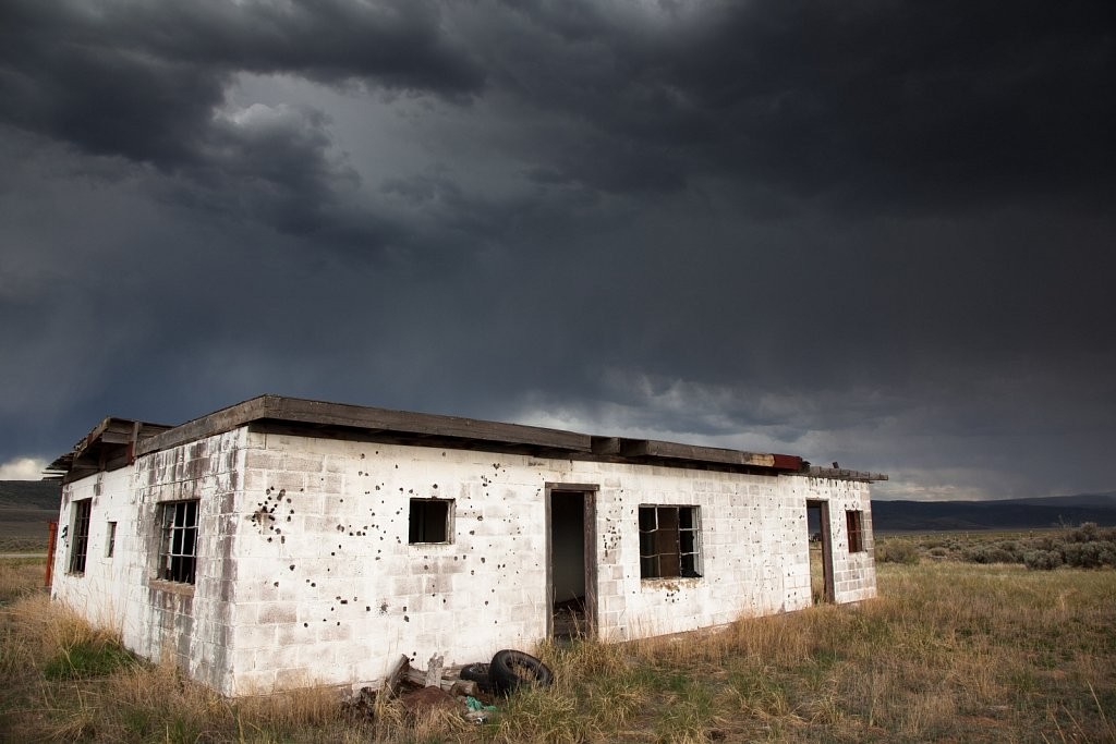 Old Concrete shack under cloudy skies in southern Colorado