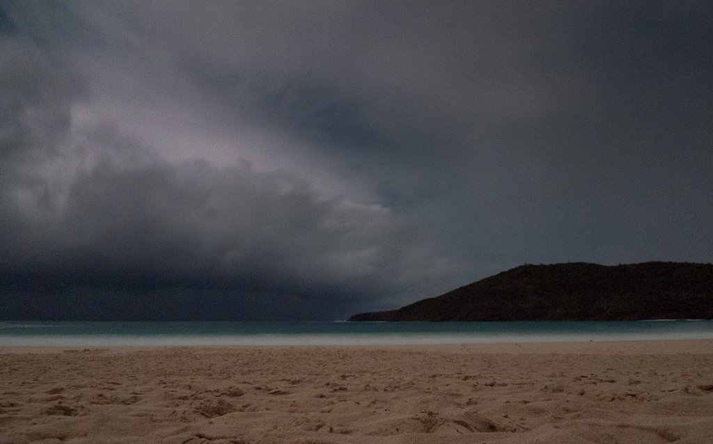 Beach scene at night during a storm in Culebra