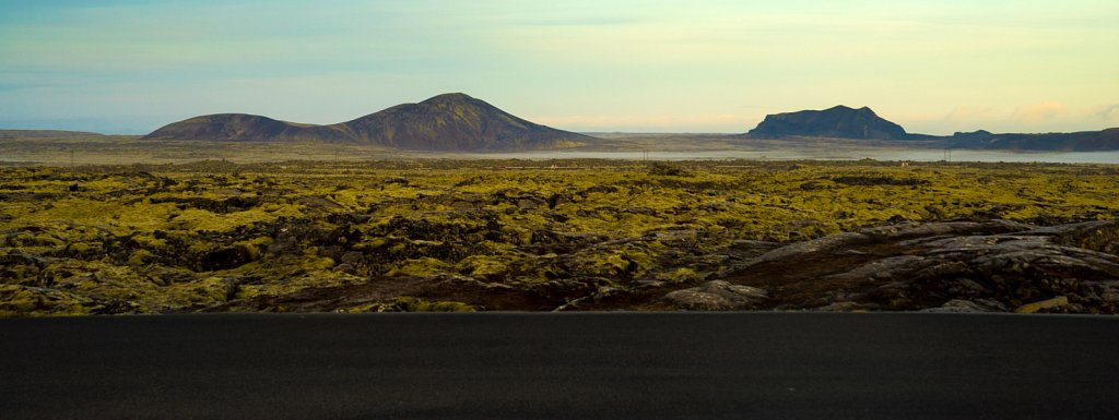 Lava fields and empty hills and fresh blacktop road